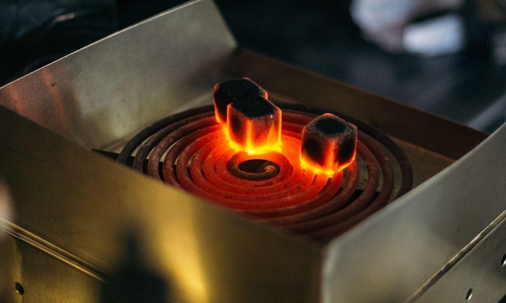 Shisha Coal stove and coals burning on top