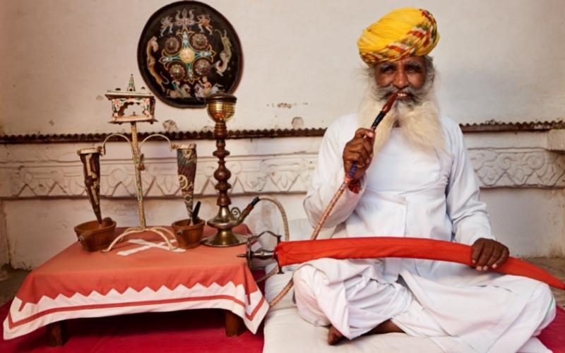 Indian man smoke Indian shisha